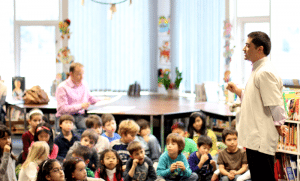 Dr. speaking to children in a classroom